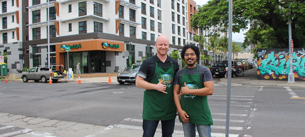 Kakaako Store Managers Steve and Mark-Anthony posing in front of Kakaako