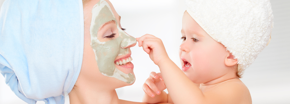 Family beauty treatment in bathroom. mother and daughter