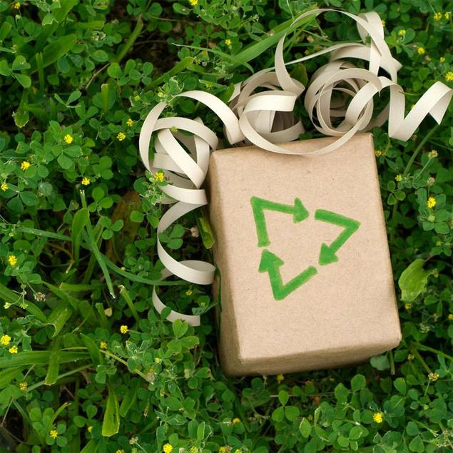 Photo: Gift wrapped in brown paper with a recycle symbol