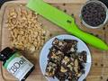 Photo: Peanuts, Chocolate Chips and CBD Oil on a Cutting Board