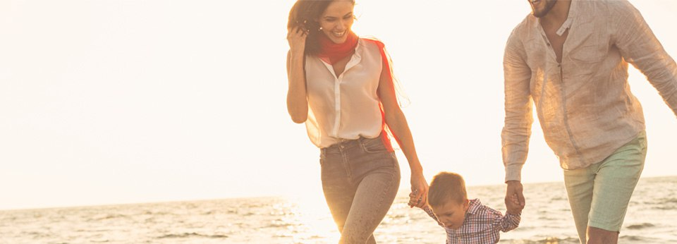 Photo: Family walking along the beach