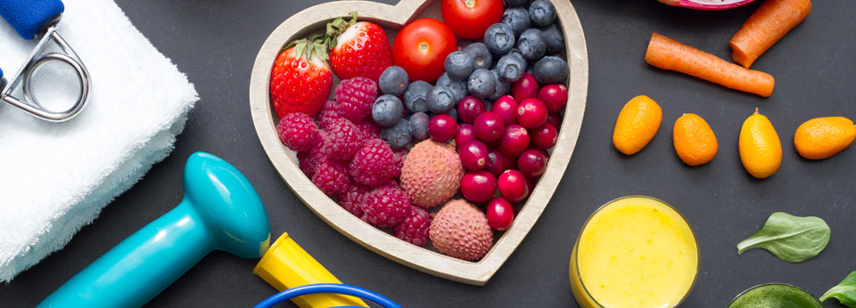 Photo: Healthy heart diet and sport gym equipment concept on blackboard