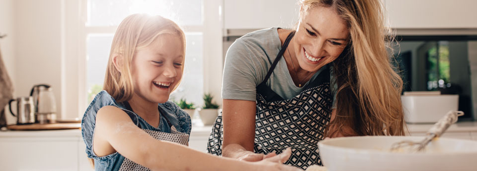 Photo: Mother and child cooking together