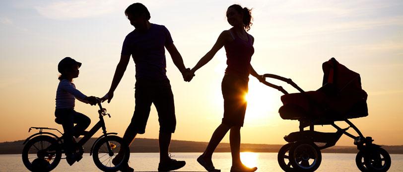 Photo: Family walking during sunset
